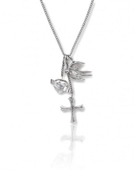 Unsere Silber Kette mit den Glaube Liebe Hoffnung Anhaengern Herz, Schwalbe und Kreuz passt super zu Bluse oder Shirt!