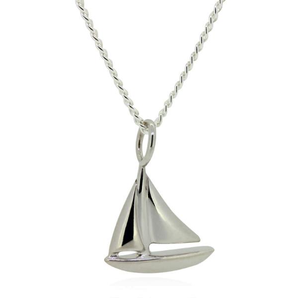wunderschoene Silber Kette mit einem Segelboot als Anhaenger aus Weissgold